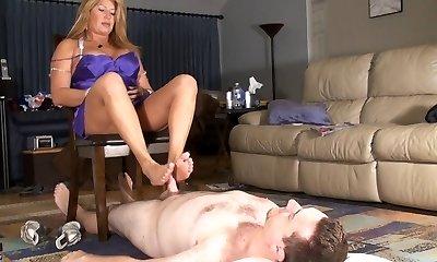 Step-mom gives cuck smooth footjob