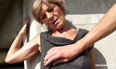 Hot tattooed grandma enjoys giving oral pleasure