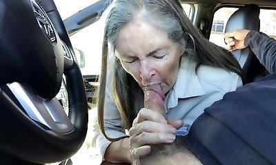 Grandma inhales in the car