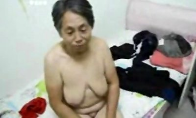 Asian Grannie get dressed after sex