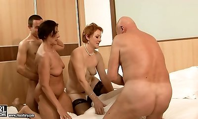 Two big moms make out with their lovers in group sex orgy