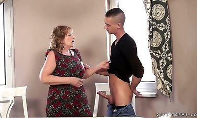 Insane granny Sally G boinks a handsome student on the couch