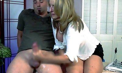 Mom gives son a hand-job