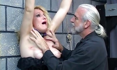 Old blonde cougar gets strapped in for some discipline