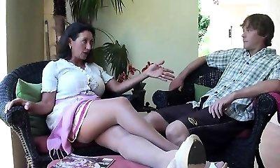 Brunette babe with lovely breasts on floor providing hot handjob