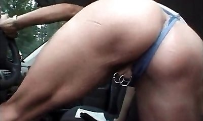 Milf with pierced pussy and nipples masturbating in the truck
