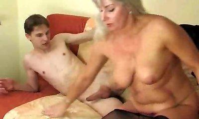 Young man enjoying a horny older doll