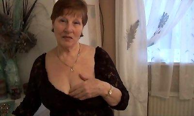 Hairy grannie in crotchless panties posing