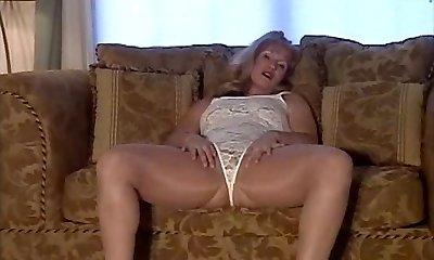 mature in shining pantyhose