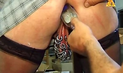 My luxurious piercings - mature pierced slave with bottle in ass