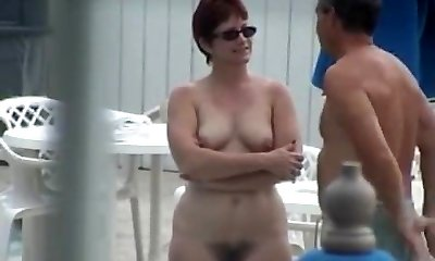 Cute Mature with Full Pubic Hair Bare by the Pool
