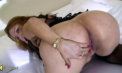 Big mama loves to play with her senior pussy