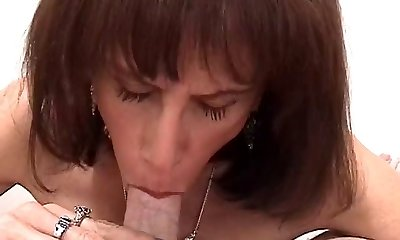 Skinny aging slutbag wraps her gross mammories around white fuckpole