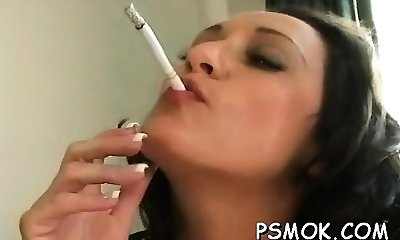 Mature doxy blows a youngster while smoking a ciggie