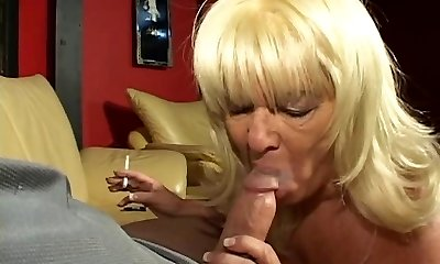 Blonde mature cock blowing granny enjoys a ciggie and a hard dick