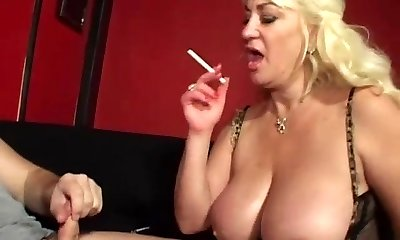 Huge-chested mother gives blowjob and smokes cigarette