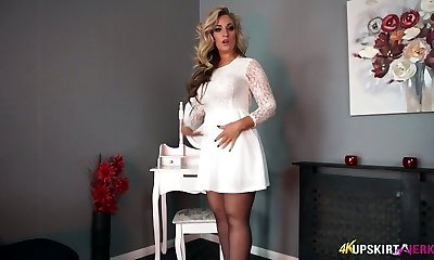 Lovable light-haired mommy Kellie O Brian displays what she got under her skirt