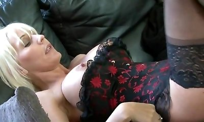 Sexy light-haired hooker in stockings