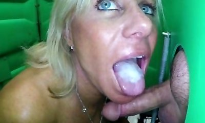 Mature Platinum-blonde giving public oral jobs to strangers