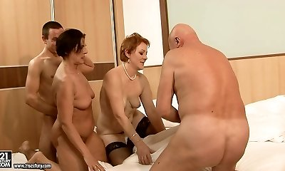 Two immense moms make out with their lovers in group hookup orgy