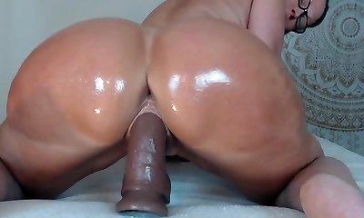 Big asses milf riding a dildo