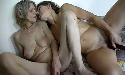 Filthy girl-on-girl scene with two ugly saggy tittied ugly grandmas