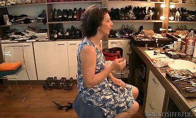 Dark-haired granny is poked upskirt from behind in Pov
