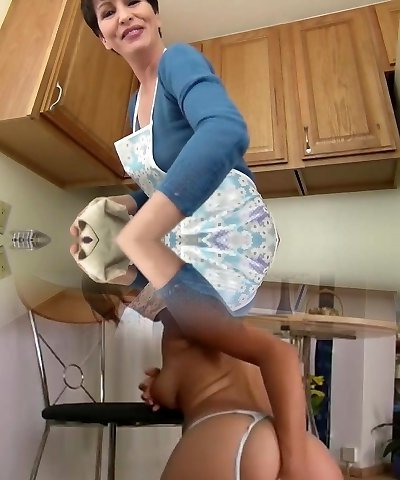 Mother teasing in the kitchen...