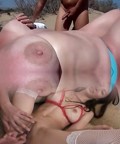 Two sexually aroused daddies fap off to a buxomy mother at the beach of Cap d'Agde