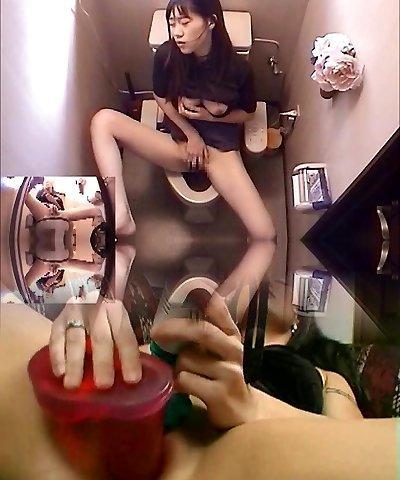 Asian Lady In Toilet Masturbation