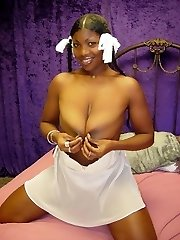 Ebony amateur poses on the bed in white lingerie