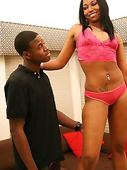 Ebony teen in pink lingerie rubs her clit while banging stiff black dick