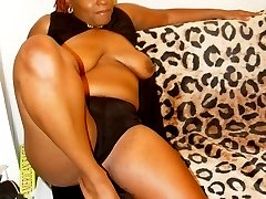 Queen Bee is a thick ebony sister with red hair and ass for days. She loves to remove her lingerie that show off her large natural black boobs & round apple bottom