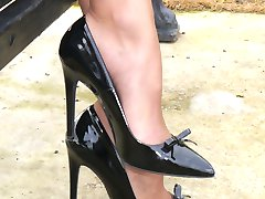 Hot blonde Milf Monica shows off her hot legs and shiny black stiletto heels