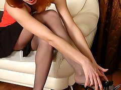 Naughty chick in reinforced toes pantyhose putting to work high heel shoes