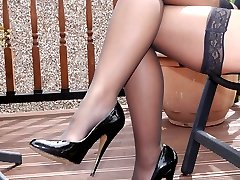 Amy knows how high heels really shape her legs and cause men to look at her, so why not give in...