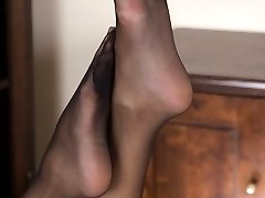 Tracy gets into a teasy nylon foot job vibe, imagining you were there...