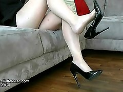 Jackies high heel shoe fits nice and snug on her shapely foot. While you think about the height...