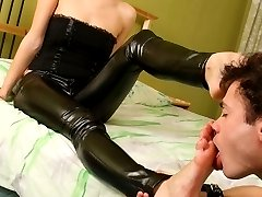 Gorgeous mistress in latex tearing slaves mouth with her beautiful bare feet