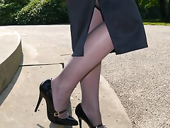 Lovely Sara is outdoors posing in a pair of silky nylon stockings and stunning black stiletto...