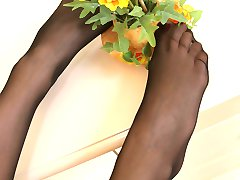 Well-shaped chick in expensive pantyhose taking pride in her yummy feet