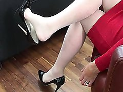 With your fetish in mind Jackie shows the high heel, the sole and low cut cleavage of her sexy...