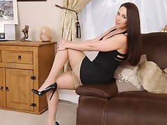 Hot leggy brunette Imelda parades her sexy legs in the bedroom wearing nylons and black high...