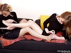 Sexy babes petting each other with polished feet clad in open toe pantyhose