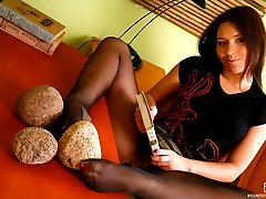 Sweltering brunette tongue-polishing her pedicured feet in black pantyhose