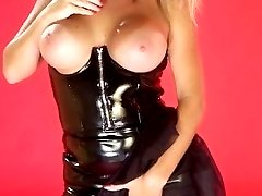 Blonde mature smokes cigar in black latex dress