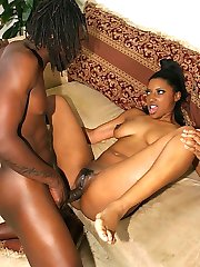 Tattooed nubian slut strokes and sucks a monster black dick