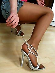Smoking hot chick parades her nylon clad feet fooling around in the kitchen