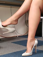 Hot office girl Donna teases in the home office in her silky nylons and beautiful high heels