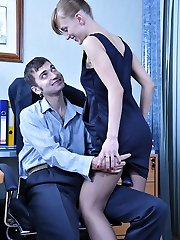 Office hottie in shiny dark pantyhose seducing her co-worker into a quickie